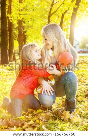 Portrait of happy,Caucasian sisters smiling and hugging outdoors. Shallow doff and lens flare. - stock photo