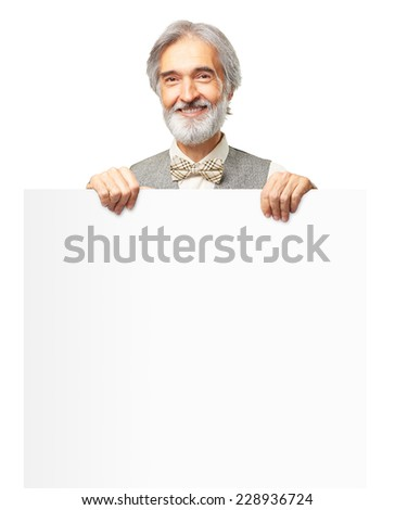 Portrait of happy caucasian smiling senior man with a gray beard and bowtie holding banner isolated on white background - stock photo