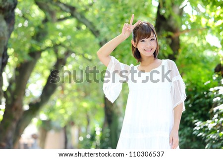 Portrait of happy cheerful smiling young beautiful japanese woman outdoors