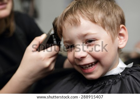 Portrait of happy child at the barbershop