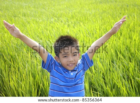Portrait of happy child in the green rice fields - stock photo