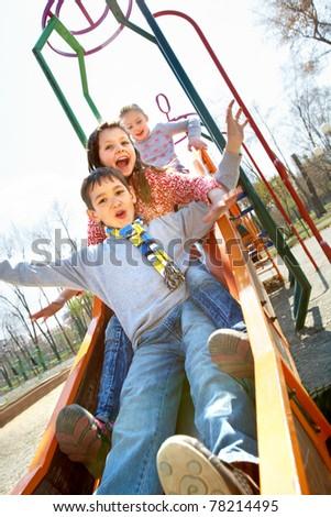 Portrait of happy children having fun outside - stock photo