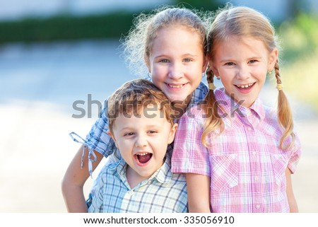 Portrait of happy children near a house at the day time. Concept Brother And Sister Together Forever - stock photo