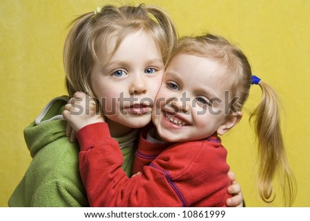 Portrait of happy children on a yellow background - stock photo