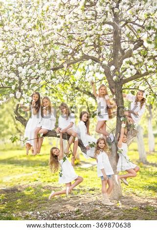 Portrait of happy children on nature in summer - stock photo
