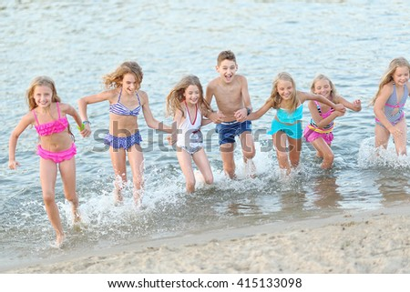Portrait of happy children on nature in summer