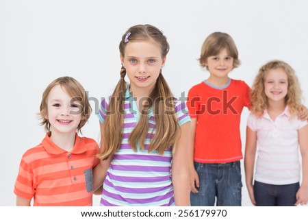 Portrait of happy children standing isolated on white background