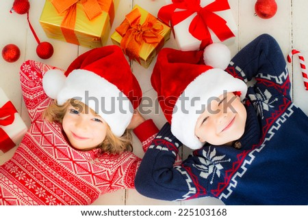 Portrait of happy children with Christmas decorations. Two kids having fun at home - stock photo