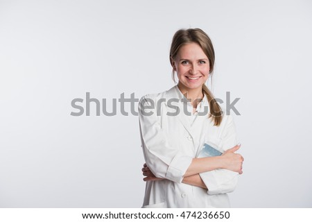 Portrait of happy clinician looking at camera and smiling with hands crossed