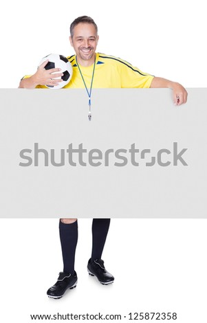 Portrait Of Happy Coach Holding Placard And Football Isolated On White Background - stock photo