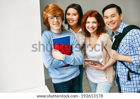 Portrait of happy college friends looking at camera with smiles - stock photo