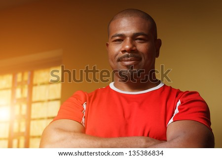 Portrait of happy confident African American male athlete. Closeup. - stock photo