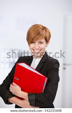 Portrait of happy confident businesswoman with blinder in office