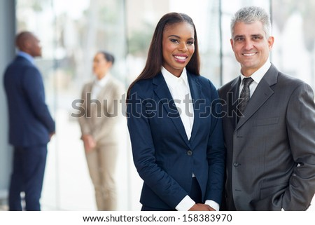 portrait of happy corporate colleagues in modern office - stock photo