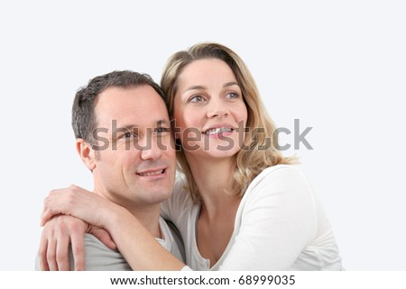 Portrait of happy couple at home - stock photo