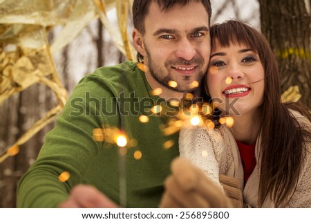 portrait of happy couple at winter - stock photo