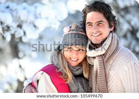 portrait of happy couple at winter resort - stock photo