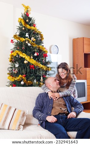 Portrait of Happy couple celebrating Christmas at home