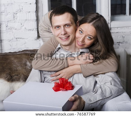 portrait of happy couple, giving a gift