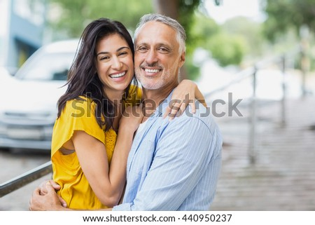 Portrait of happy couple hugging outdoors