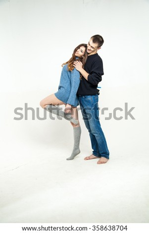Portrait of happy couple isolated on white background. Attractive man and woman being playful. - stock photo
