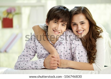 Portrait of happy couple looking at camera and smiling - stock photo