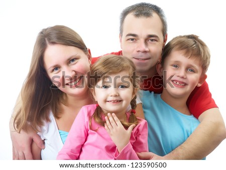Portrait of happy couple with two children of white background - stock photo