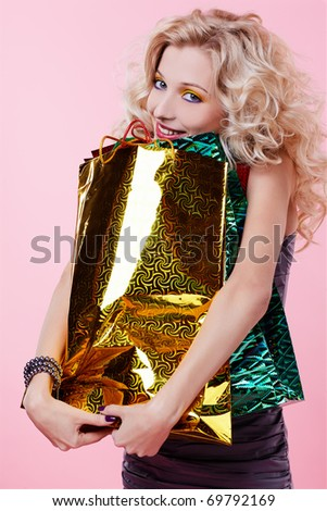 portrait of happy customer blonde girl with shopping bags