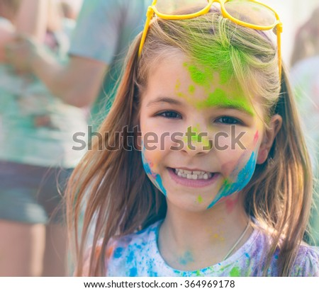 Portrait of happy cute litttle girl on holi color festival - stock photo