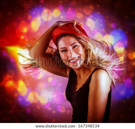 Portrait of happy dancing girl on pink glowing lights background, dance club, Christmas party, famous Dj, night performance concept