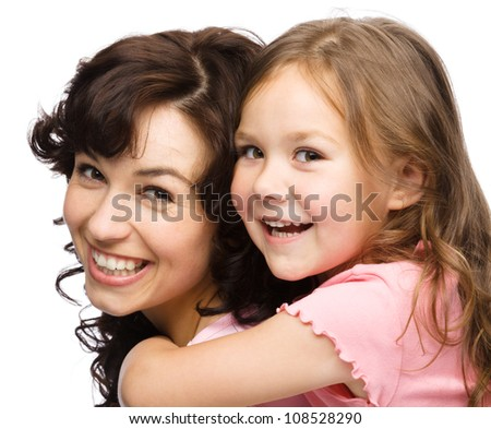 Portrait of happy daughter enjoying a piggyback ride on mothers back, isolated over white - stock photo