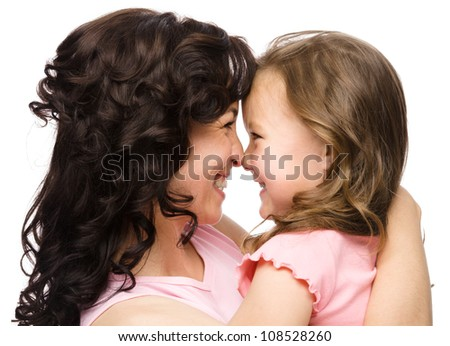 Portrait of happy daughter smiling at her mother, isolated over white