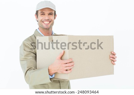 Portrait of happy delivery man carrying cardboard box against white background - stock photo