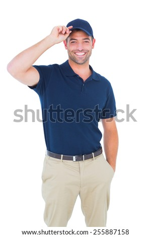 Portrait of happy delivery man wearing cap on white background - stock photo