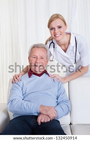 Portrait Of Happy Doctor And Patient; Indoor - stock photo