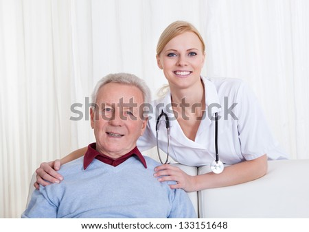 Portrait Of Happy Doctor And Patient; Indoor