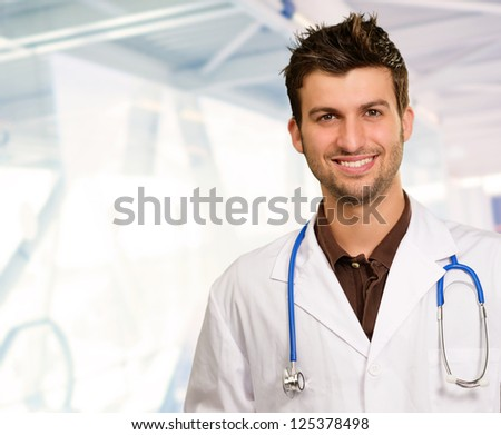 Portrait Of Happy Doctor, Indoors - stock photo