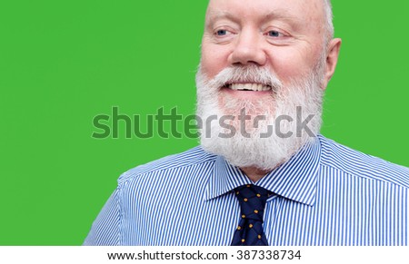 Portrait of happy elderly man posing on green background, color and contrast manipulated - stock photo