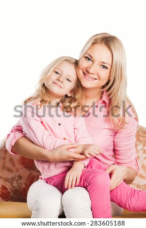 Portrait of happy embracing mother and daughter. happy family concept - stock photo