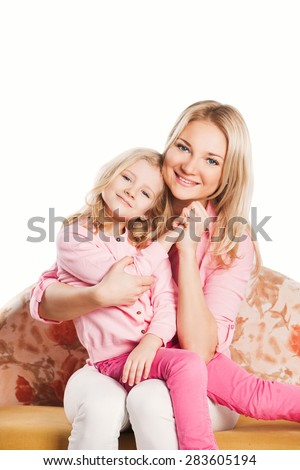 Portrait of happy embracing mother and daughter. hugging mother and daughter - stock photo