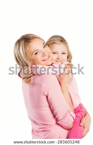 Portrait of happy embracing mother and daughter on white background. family, children and happy people concept