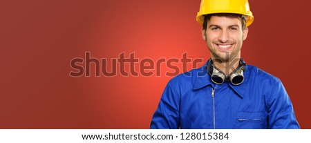 Portrait Of Happy Engineer Isolated On Red Background - stock photo