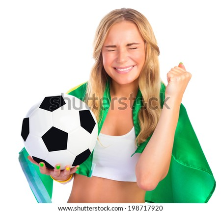 Portrait of happy excited Brazilian football team fan with closed eyes isolated on white background, holding in hand ball and Brazil flag, winning in championship concept - stock photo