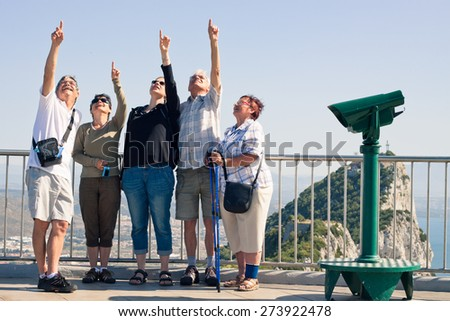 Portrait of happy excited tourists people on the Rock of Gibraltar. - stock photo