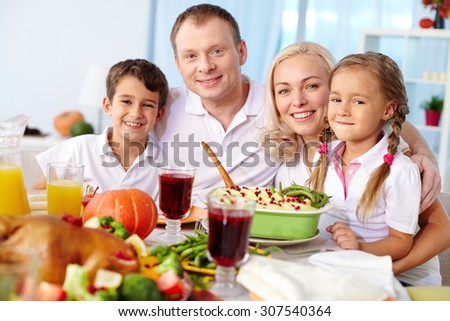 Portrait of happy family at festive table - stock photo