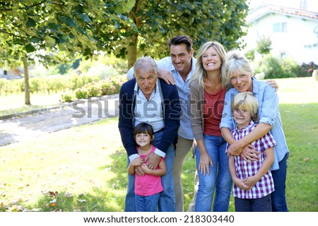 Portrait of happy family at grandparents's house - stock photo
