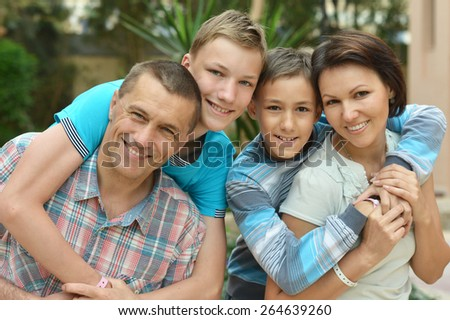 Portrait of Happy family at tropical resort - stock photo