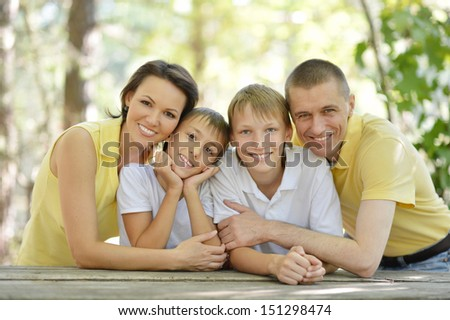 Portrait of happy family at wooden table