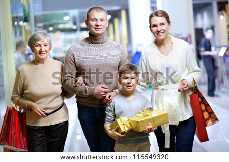 Portrait of happy family during shopping in the mall before Christmas - stock photo