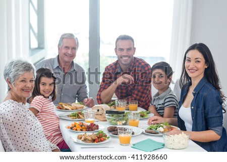 Portrait of happy family having breakfast in the morning - stock photo